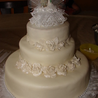 "First Wedding Cake This was my first every wedding cake. I used Betty Crocker White Cake mix. The Cake is made of a 12"", 8"", and 6"" round. I..."