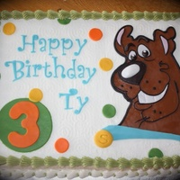 Scooby Birthday This cake is made to match the invitations. Scooby is made from fondant.