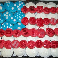 Fourth Of July Cupcakes This was a fourth of july flag done with cupcakes and candy. Using miscellaneous red and white candies with regular and mini cupcakes with...