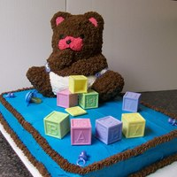 Teddy Bear Baby Shower Cake Teddy bear baby shower cake done with buttercream icing. The teddy bear was done with the teddy bear pan and piped stars. The plastic...