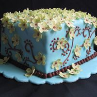 Flowers And Swirls Cake Fondant covered cake with gumpaste flowers and royal icing swirls