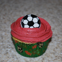 Soccer Cupcakes golden butter cupcakes with buttercream and fondant soccer ball for my daughter's end of season party. Red is their team color.