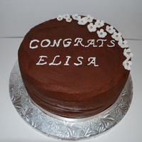 Chocolate Mousse Graduation Cake chocolate cake with chocolate mousse and chocolate fudge between layers. Dark chocolate buttercream with gumpaste flowers with dragees. My...