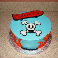 Skateboard Cake 2 10 inch rounds iced in buttercream, fondant accents, skateboard is gumpaste