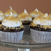 Smores MacsMom chocolate cake recipe topped with a chocolate glaze, marshmallow and graham cracker crumbs.