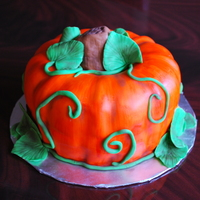 Pumpkin Cake I used my bundt pan for this:) SW golden butter cake with buttercream under fondant. Painted the fondant with wilton orange mixed with...