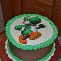 Yoshi My son was in to mario amd wanted a Yoshoi cake. First to I'v ever used an icing sheet. Chocolate and white cake white bc