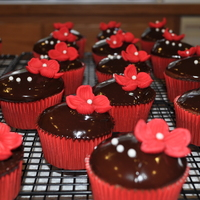 Valentines Day Cupcakes Chocolate cupcakes filled with raspberry mousse dipped in Chcolate ganache. Fondant flowersw