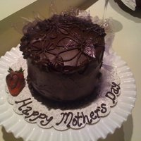 Mother's Day Cake For My Mom  Found a really good combination! Devil's food cake, fresh whipped cream and sliced strawberry filling, covered in ganache, YUM! After...