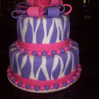 Zebra Cake This cake was made for a girl turning ten who wanted zebra but her favorite colors were pink and purple so this is what happened!..Her...