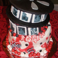 Movie Reel Engagement Cake  This was a cake for a rehearsal dinner. The colors were red, black, and white...with a heart theme. They wanted to incorporate their...