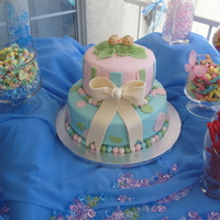 Twins Baby Shower I was given a picture of this cake by the mom of the twins. Not sure who the original designer is. Bottom is a yellow cake with vanilla...