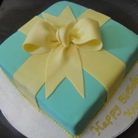 "Gift Box Birthday Cake This is a 10"" square butter cake with nuts and a vanilla custard filling. Covered and decorated with MMF."