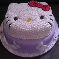 Hello Kitty Hello Kitty cake for my niece's 4th birthday. Bottom is a white cake with white chocolate ganache and berries, top is a coconut cake...