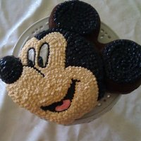 Mickey Mouse I made this cake for my baby's 2nd birthday. I used the Mickey Mouse pan from Wilton. Ideally, I had to do buttercream frosting so my...