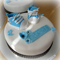 Baptism Cakes 3 cakes for little Charlies baptism. The request was white, brown and ´different shades of blue, baby converse, train, baby...