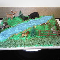 Wilderness Cake BC sheet cake with animals the mom bought for her daughter!