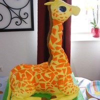 Giraffe strawberry cake with strawberry buttercream. rice crispy treats neck, all covered in mm fondant.