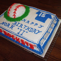 Base Ball Birthday Cake This was a chocolate 1/2 sheet cake. Ball on top was also chocolate. Grandsons ball team was used as theme. Buttercream icing. Layer was...