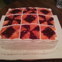 """quilter's Cake""   2 layer bakery type icing on top & inbetween layers. Rasberry Jam & Apricot make the ""quit"" design."