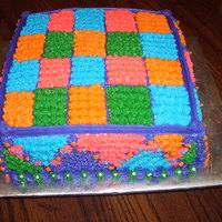 "Patch Work Used Star tip to make individual ""quilt"" squares. used 10"" square pan. Yellow cake with regular bakery icing. Everyone loved..."