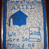 Graduation   School colors were Blue & Gray. Mother wanted a Red Velvet Cake. Had regualar white bakery icing, colored to match her school colors.
