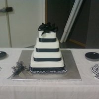"Black And White With Bow 12"", 10"", 8"". 6"" with MMF. This was my first wedding cake and a gift to the bride."