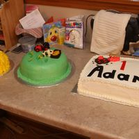Farm Cakes  The smash cake is made of DH White cake and BC icing. The middle pasture cake is made from DH White cake, BC icing with fondant covering...