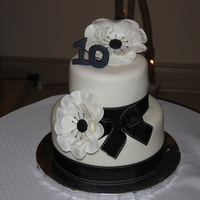 Black And White Anenome Cake The theme for the anniversary was black and white so I tried making my first gumpaste flowers!!! I think they turned out pretty well for my...