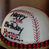 Baseball Cake Baseball cake iced in buttercream. Red velvet cake with cream cheese filling.