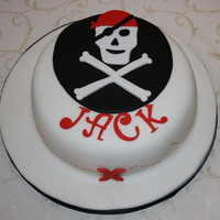 Pirate Birthday Sponge covered in fondant. Boy's only pirate party, one cake saved for school the next day with a slight change to incorporate both...