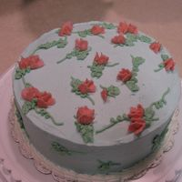 Final Cake - Wilton Course Level 1 I had wanted to incorporate more flowers that I had learned, including the rose - but do to high humidity (97%) the icing would NOT...