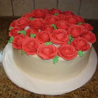 Roses buttercream icing with royal icing roses