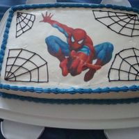Spiderman buttercream icing with spiderman icing image