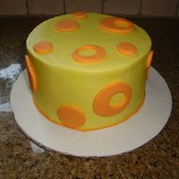 Yellow/orange Circles yellow buttercream withorange fondant polka dots