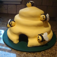 Busy Bees Fondant covered with modelling paste bees. It's a Debbie Brown cake. My first fondant covered attempt.