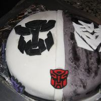 Transformers Cake Root Beer Float cake with root beer float flavored filling covered in black and white fondant.