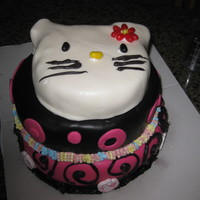 Hello Kitty Birthday Cake I made this Hello Kitty themed 3 tier birthday cake for my niece's 13th birthday. Bottom layer is triple chocolate fudge cake with...