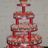 Mini-Cupcake Cake This is my first Mini cupcake cake. It was for a Lawyers office who celebrated their 5th year anniversary and x-mas at the same time