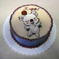 Moogle Cake This was just a cake I made for practicing writing, frosting the sides a different color, combing the sides, attempting my first shell...