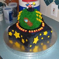Super Mario Galaxy Birthday cake for two brothers, 9 and 10. It's my version of the Mario Galaxy cake by DC0630. Base was made with Wilton star pan with...