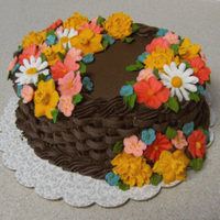 Wilton Course 2 Final Cake I'm not completely in love with this cake, but I didn't plan my palette as thoroughly as I would have liked. Also, my basketweave...