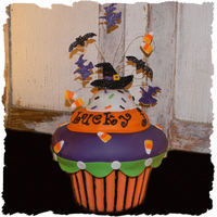 Spooktacular Cupcake Made this for a halloween themed jewelry party. Bottomwrapper is chocolate melts and top is sculpted rice crispy treats decorated with...