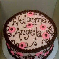 Welcome Baby Girl Chocolate fudge cake with buttercream filling and buttercream and chocolate frosting.