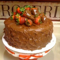 Chocolate Covered Strawberry Cake Chocolate fudge cake filled with fresh strawberries and strawberry preserves, iced with chocolate frosting and fresh chocolate covered...