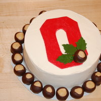 Ohio State Birthday Cake White cake with strawberry filling. Frosted in buttercream, fondant decorations on top. 35 real buckeyes (not fondant) for the birthday boy...