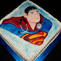 "Super Medic Superman fondant relief with fondant stethoscope around his neck. SUPER MEDIC. Placed on a 12"" square cake covered in buttercream."