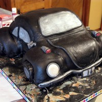 1St Vw Bug  Hopefully I will get better at this. My first VW Bug. Some white some chocolate cake. Iced w/buttercream under MMF. Airbrushed pearl. Tag...