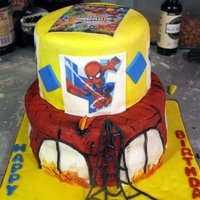 Super Hero Squad  Cake for 30. Superhero Squad. Hot Cocoa cake with Indydebi buttercream under MMF. Edible images. I wanted the building (bottom tier) to...