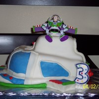 Buzz Lightyear Space Ship This was for my son's 3rd bday. It was my first carved cake and my first time using homemade fondant. I think I did pretty good. Thank...